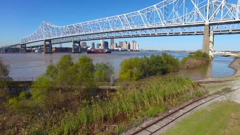 Rising-shot-of-the-Crescent-City-Bridge-over-the-Mississippi-River-reveals-the-New-Orleans-Louisiana-skyline