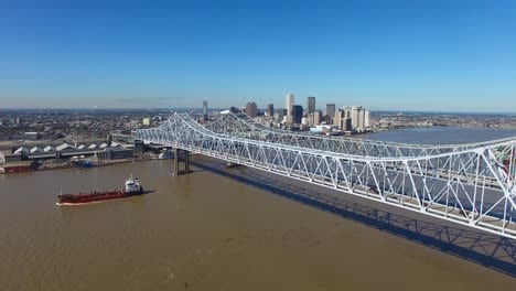 Excellent-aerial-shot-of-the-Crescent-City-Bridge-over-the-Mississippi-River-revealing-the-New-Orleans-Louisiana-skyline