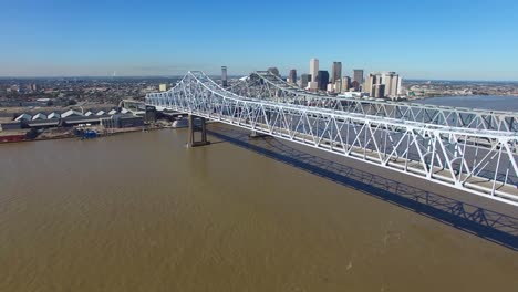 Aerial-shot-of-the-Crescent-City-Bridge-over-the-Mississippi-River-revealing-the-New-Orleans-Louisiana-skyline-1