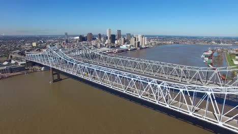 Stationary-aerial-shot-of-the-Crescent-City-Bridge-over-the-Mississippi-River-revealing-the-New-Orleans-Louisiana-skyline