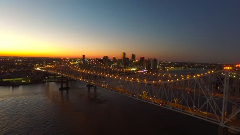 Beautiful-rising-night-aerial-shot-of-the-Crescent-City-Bridge-over-the-Mississippi-River-revealing-the-New-Orleans-Louisiana-skyline