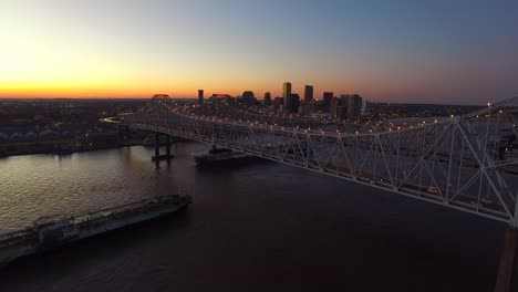 Beautiful-night-aerial-shot-of-the-Crescent-City-Bridge-over-the-Mississippi-River-revealing-the-New-Orleans-Louisiana-skyline-1
