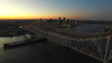 Beautiful-night-aerial-shot-of-the-Crescent-City-Bridge-over-the-Mississippi-River-revealing-the-New-Orleans-Louisiana-skyline-2