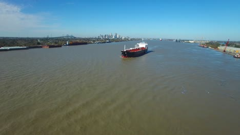 Remarkable-aerial-shot-over-a-massive-tanker-ship-traveling-on-the-Mississippi-River-outside-New-Orleans-Louisiana