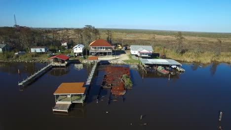 An-aerial-stationary-shot-over-the-Louisiana-bayou-reveals-a-local-community