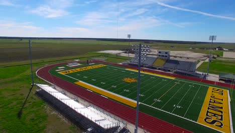 Excellent-aerial-over-a-modern-high-school-football-stadium-in-the-flatlands-of-Texas-or-Louisiana