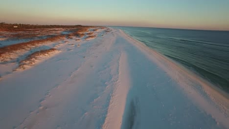 A-beautiful-aerial-shot-over-white-sand-beaches-at-sunset-near-Pensacola-Florida