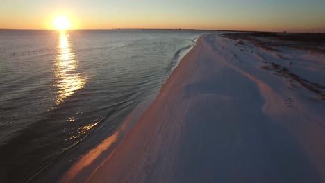 A-beautiful-aerial-shot-over-white-sand-beaches-at-sunset-near-Pensacola-Florida-1