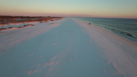 A-beautiful-aerial-shot-over-white-sand-beaches-at-sunset-near-Pensacola-Florida-2