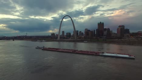 Beautiful-aerial-over-a-Mississippi-river-barge-with-the-St-Louis-Missouri-skyline-background-2
