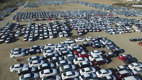 Aerial-perspective-of-new-import-cars-sitting-in-a-lot-awaiting-distribution-and-sale