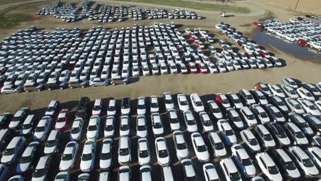 Aerial-perspective-of-new-import-cars-sitting-in-a-lot-awaiting-distribution-and-sale-1