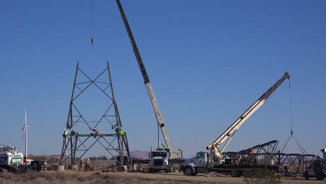 American-workers-assemble-high-tension-electrical-transformers-and-cables-to-build-US-infrastructure