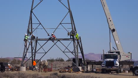 American-workers-assemble-high-tension-electrical-transformers-and-cables-to-build-US-infrastructure-1