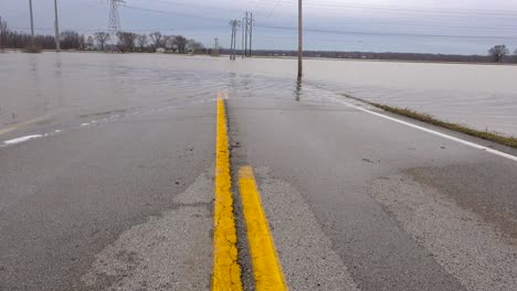 Tilt-up-of-flooding-washing-out-a-road-during-intense-storms-in-Missouri-in-2016