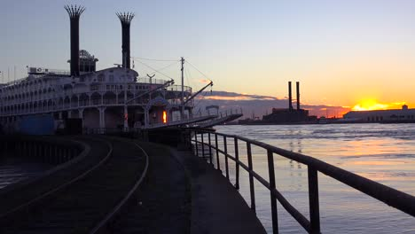 Beautiful-shot-of-a-large-Mississippi-paddlewheel-riverboat-docked-at-sunset-near-New-Orleans