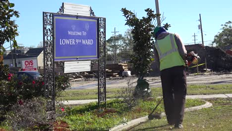 Workers-clean-up-and-beautify-the-Lower-9th-Ward-of-New-Orleans-Louisiana-post-Katrina