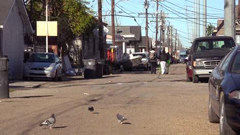 People-walk-on-the-street-in-an-african-american-neighborhood-in-New-Orleans-Louisiana