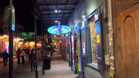 Tilt-down-to-an-establishing-shot-of-Bourbon-Street-in-New-Orleans-at-night