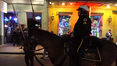 Mounted-police-force-patrols-on-Bourbon-Street-in-New-Orleans-at-night