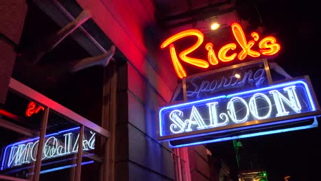 Neon-sign-for-Rick-s-Saloon-on-Bourbon-Street-in-New-Orleans-at-night