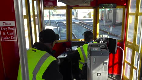 Point-of-view-shot-looking-through-a-New-Orleans-streetcar-as-it-travels-through-the-city