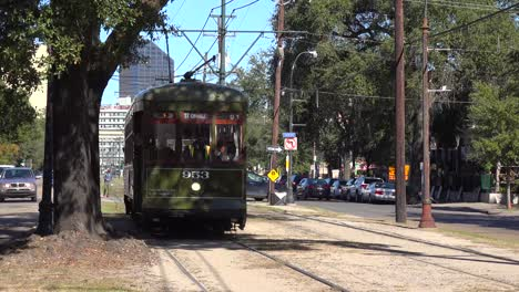 A-green-New-Orleans-streetcar-travels-through-the-city