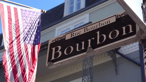 Bourbon-Street-sign-French-Quarter-New-Orleans-with-American-flag