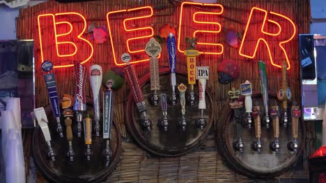 A-neon-sign-at-a-tiki-bar-advertises-beer