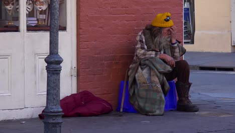 A-homeless-man-sits-on-the-street