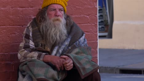 A-homeless-man-sits-on-the-street-1