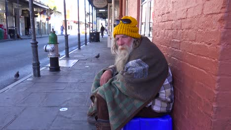A-homeless-man-sits-on-the-street-2