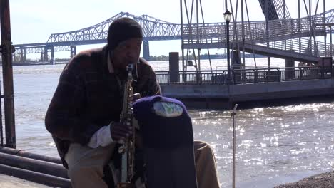 A-homeless-musician-plays-jazz-music-along-the-Mississippi-River-in-New-Orleans