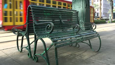 A-red-trolley-passes-a-green-bench-in-New-Orleans