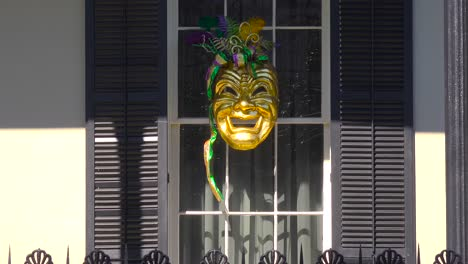 A-Mardi-Gras-mask-is-displayed-in-a-window-in-new-Orleans