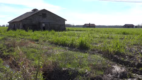 Wooden-cabins-used-by-slaves-still-stand-on-a-plantation-in-the-deep-south