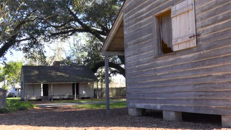 Wooden-cabins-used-by-slaves-still-stand-on-a-plantation-in-the-deep-south-4