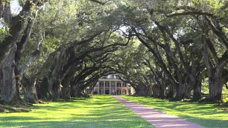 A-wide-shot-of-a-beautiful-gracious-Southern-mansion-on-an-estate-amongst-oak-trees