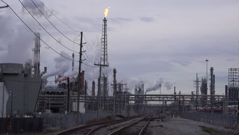 A-huge-oil-refinery-emits-smoke-and-fire-into-the-sky-1
