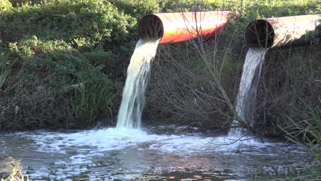 Contaminated-water-is-dumped-into-a-waterway-through-industrial-pipes-2