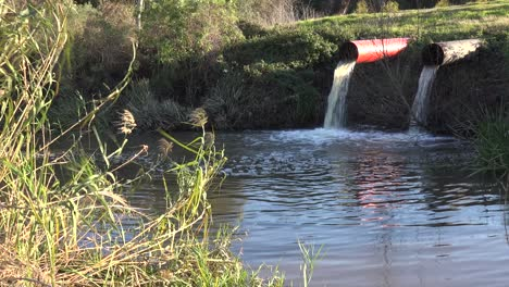 Contaminated-water-is-dumped-into-a-waterway-through-industrial-pipes-3