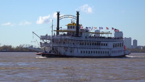 A-paddlewheel-steamboat-passes-on-the-Mississippi-River-with-new-Orleans-in-the-background