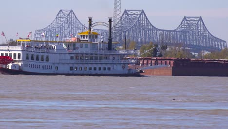 A-paddlewheel-steamboat-passes-on-the-Mississippi-River-with-new-Orleans-in-the-background-1
