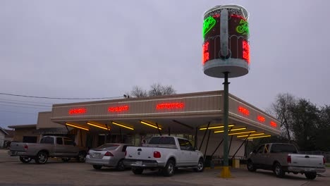 A-drive-up-diner-with-a-giant-root-beer-mug-sign-rotating