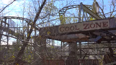 A-decaying-roller-coaster-at-an-abandoned-amusement-park-presents-a-spooky-and-haunted-image