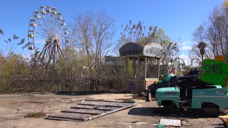 An-abandoned-and-graffiti-covered-amusement-park-presents-a-spooky-and-haunted-image