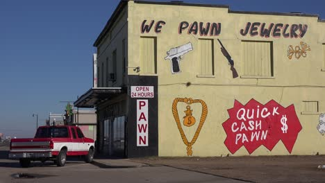Establishing-shot-of-a-pawn-shop-with-a-sign-saying-we-pawn-jewelry""""""""