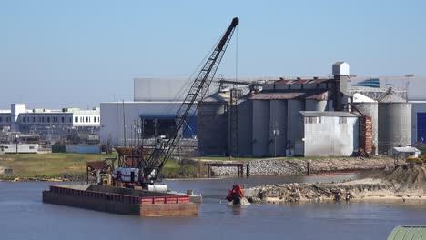 A-large-crane-sitting-on-a-barge-dredges-a-harbor