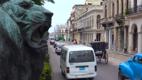 Traffic-passes-on-the-streets-of-the-old-city-of-Havana-Cuba-with-classic-old-cars-