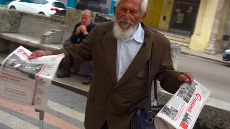 A-man-sells-magazines-and-newspapers-on-the-streets-of-Havana-Cuba